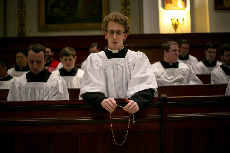 Seminarian Jordan Evans prays the rosary in a chapel at St. Charles Borromeo Seminary in Wynnewood, Pa., on Wednesday, Feb. 5, 2020. After scandals in the Catholic Church, future priests say they hope their examples of piety will restore faith in the clergy. (AP Photo/Wong Maye-E)