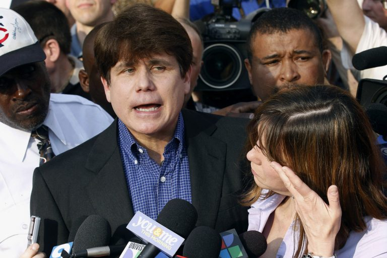 FILE - In this March 14, 2012, file photo, former Illinois Gov. Rod Blagojevich speaks to the media outside his home in Chicago as his wife, Patti, wipes away tears a day before reporting to prison after his conviction on corruption charges. President Donald Trump is expected to commute the 14-year prison sentence of Blagojevich. The 63-year-old Democrat is expected to walk out of prison later Tuesday, Feb. 18, 2020. (AP Photo/M. Spencer Green, File)
