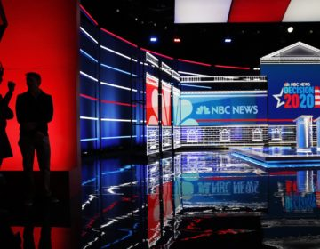 People stand on stage during setup for the Nevada Democratic presidential debate Tuesday, Feb. 18, 2020, in Las Vegas. (AP Photo/John Locher)