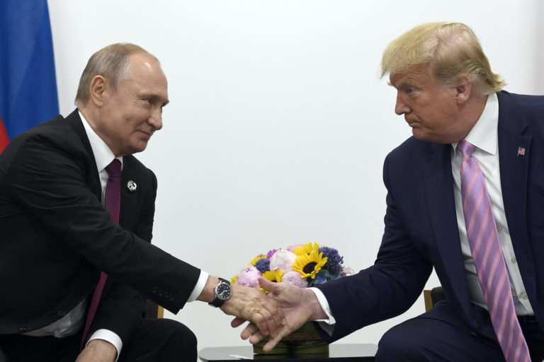 President Donald Trump, right, shakes hands with Russian President Vladimir Putin, left, during a bilateral meeting on the sidelines of the G-20 summit in Osaka, Japan, Friday, June 28, 2019. (Susan Walsh/AP Photo)