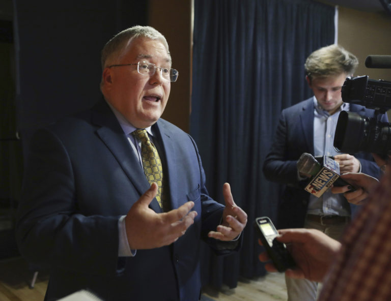 Patrick Morrisey speaks to reporters after a debate in Morgantown, W.Va. State attorneys general are finding a national settlement over the toll of opioids to be elusive, as some lawyers for state and local governments are renewing public criticism of the proposed deal with a group of companies led by the nation's largest drug distributors. (Raymond Thompson, File, AP Photo)