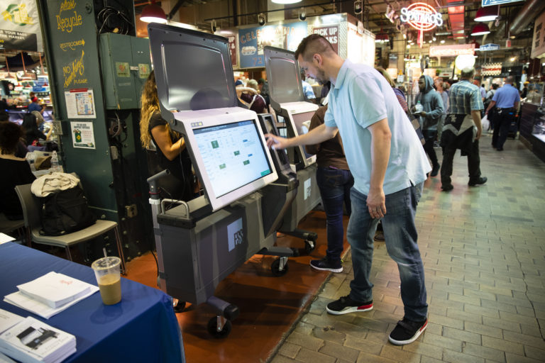 Steve Marcinkus, an Investigator with the Office of the City Commissioners, demonstrates the ExpressVote XL voting machine at the Reading Terminal Market in Philadelphia. (Matt Rourke/AP Photo, File)
