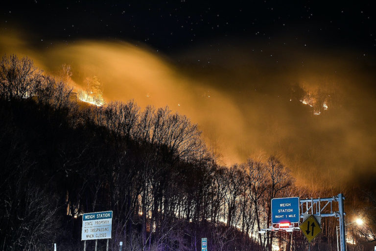 Wildfire near the New Jersey side of the Delaware Water Gap National Recreation Area near Hardwick Township, N.J., Sunday, Feb. 23, 2020. Firefighters from federal and New Jersey agencies were battling the forest fire that broke out in a popular hiking area near the Pennsylvania border. (Adam Polinger via AP Photo)