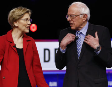 Democratic presidential candidates, Sen. Elizabeth Warren, D-Mass., and Sen. Bernie Sanders, I-Vt., talk before a Democratic presidential primary debate, Tuesday, Feb. 25, 2020, in Charleston, S.C. (AP Photo/Matt Rourke)