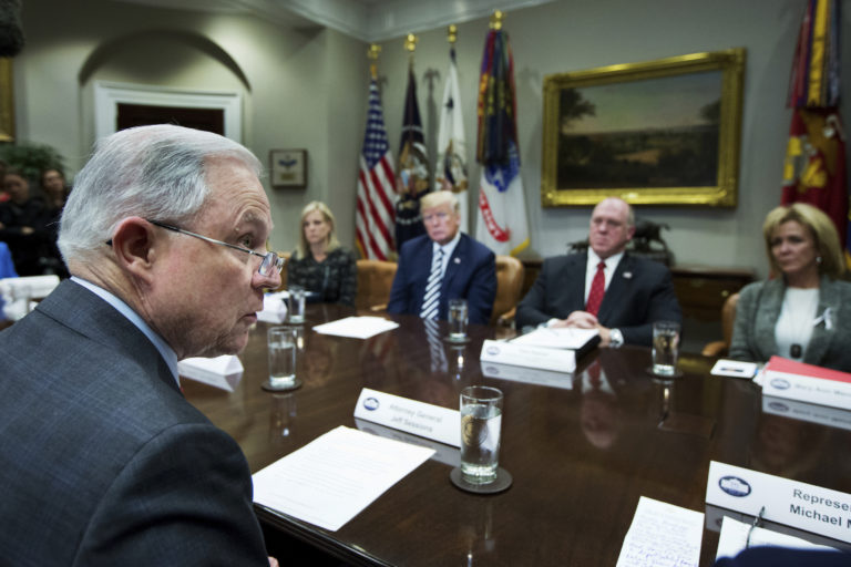 Attorney General Jeff Sessions, left, speaks during a roundtable talks on sanctuary cities hosted by President Donald Trump in the Roosevelt Room of the White House, in Washington, Tuesday, March 20, 2018. Other attendees are, from back center left, Homeland Security Secretary Kirstjen Nielsen, Trump, Immigration and Customs Enforcement Acting Director Thomas Homan and Mary Ann Mendoza. (AP Photo/Manuel Balce Ceneta)
