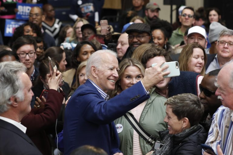 Democratic presidential candidate former Vice President Joe Biden takes photos with supporters at a campaign event at Saint Augustine's University in Raleigh, N.C., Saturday, Feb. 29, 2020. (Gerry Broome/AP Photo)