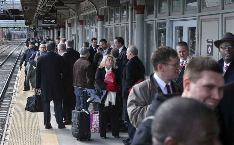 Some of the 1,000 lobbyists, business owners and politicians gather on a platform at the Trenton train station waiting to board a train to Washington, D.C., Thursday, Feb. 16, 2017 in Trenton, N.J. The state Chamber of Commerce's 80th annual trip — nicknamed the