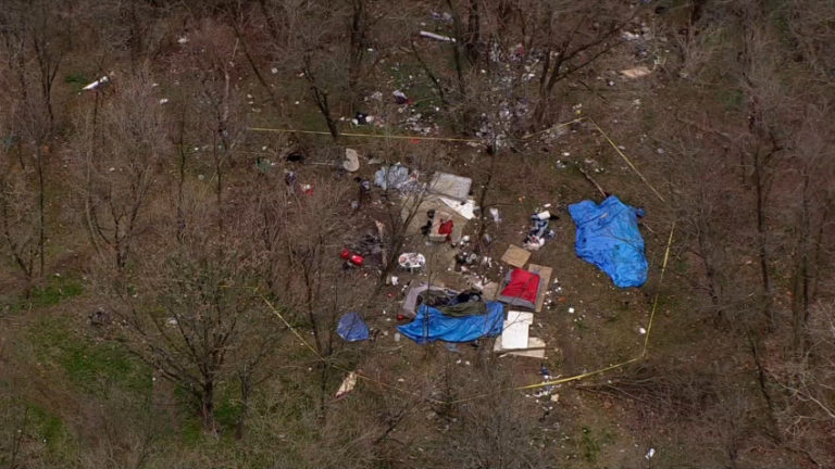 Four people experiencing homelessness were found dead inside of a tent in a Delaware woods on Monday. (NBC10)