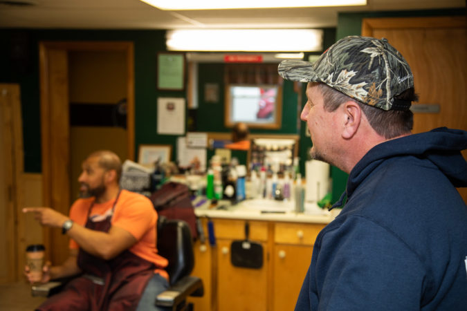 Rich Carbaugh, a Trump-supporting electrician, lingers long after his haircut at Walker's Barber Shop is over. (Jeffrey Stockbridge for Keystone Crossroads.