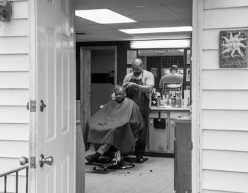 Lance Walker with a customer at his barbershop in Chambersburg, Pa. (Jeffrey Stockbridge for Keystone Crossroads)