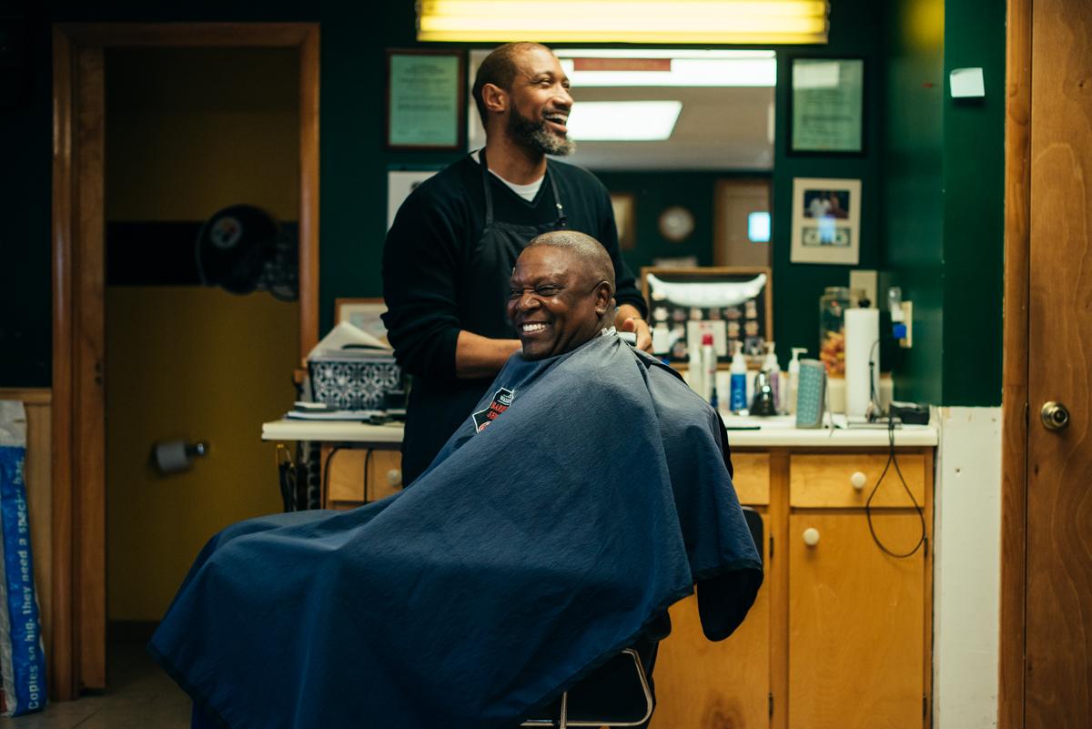 Lance Walker with a customer at his shop in Chambersburg. (Dani Fresh for Keystone Crossroads)