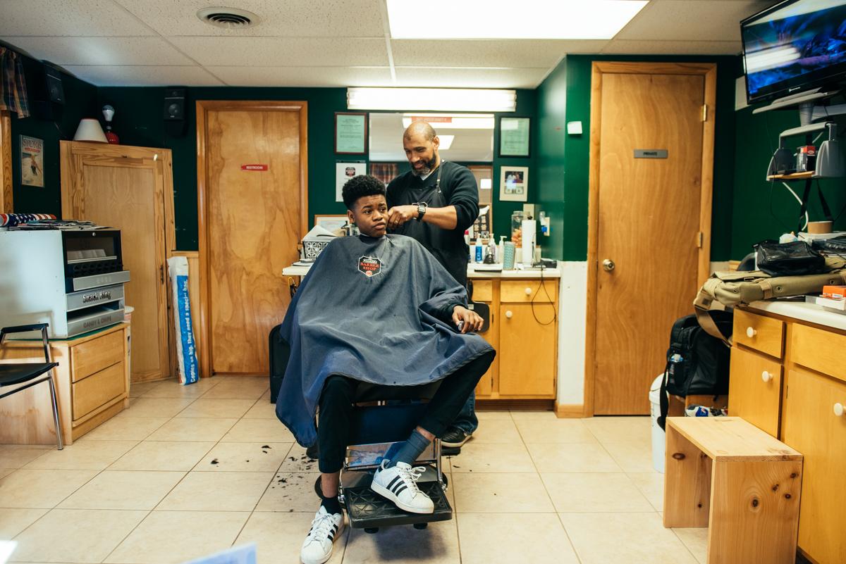 Stephen Fugate, 16, gets a trim at Walker's Barber Shop in Chambersburg, Pa. (Dani Fresh for Keystone Crossroads)