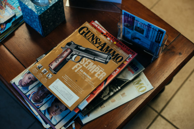 A Guns & Ammo magazine sits on the coffee table at Walker's Barber Shop, not far from a copy of The New Jim Crow. (Dani Fresh for Keystone Crossroads)