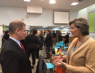 Matt Denn discusses how to influence fellow legislators with first-term Sen. Laura Sturgeon. (Cris Barrish/WHYY)