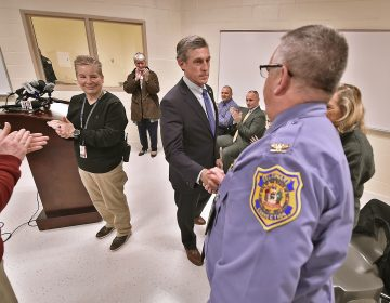 Delaware Governor John Carney shakes hands with Delaware Department of Corrections Warden Dana G. Metzger after a tour of the expanded maximum security education building at the James T. Vaughn Correctional Facility in Smyrna, Delaware on Wednesday, Feb. 5, 2020. (Butch Comegys for WHYY)
