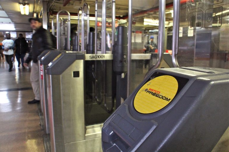 A PATCO fare gate at the 8th and Market stop.