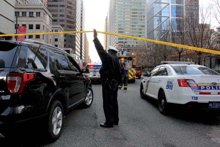 Police shut down JFK Boulevard at 17th Street after a report of an active shooter in the Sterling apartments. (Emma Lee/WHYY)