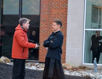At left, the Rev. Matthew Larlick of St. Joseph's in Berwick, Columbia County, speaks with another priest outside the Harrisburg diocese office after a meeting Wed., Feb. 19, 2020. (Brett Sholtis/WITF)