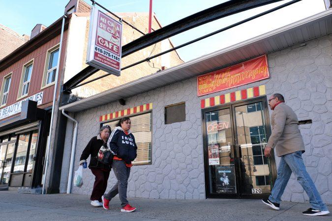 People walk past Mi Casa Su Casa cafe on Penn Street in Reading, Pennsylvania. (Matt Smith for Keystone Crossroads)