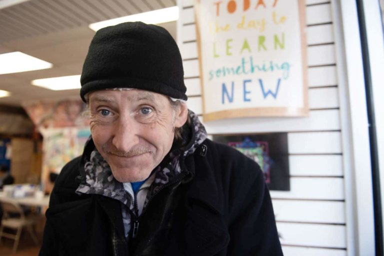 Robert Clark poses for a portrait in The Kensington Storefront on Kensington Avenue near Somerset Street. (Photo by Erin Blewett)