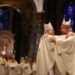 Archbishop Charles J. Chaput (left) embraces Archbishop Nelson J. Pérez (right) during his installation at the Cathedral Basilica of Saints Peter and Paul in Philadelphia on February 18, 2020. Pérez, 58, who is the 10th archbishop of Philadelphia, is the first Latino archbishop in Philadelphia. (Pool photo/The Philadelphia Inquirer)
