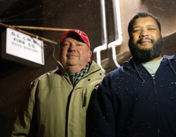 Andrew Barrow, left, and his brother Ronald Stanley Webb, Jr, nicknamed Stosh, right, stand outside Deer Lake and West Brunswick Fire Co. on Jan. 16, 2020, in Deer Lake, Pennsylvania. Webb was subjected to a racial slur while at Port Clinton Fire Company and his brother Barrow wrote an op-ed in the newspaper to bring attention to it. (Matt Smith for Keystone Crossroads)