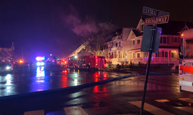 Firefighters work at the scene of a multi-alarm fire in the Ocean Grove section of Monmouth County's Neptune Township early Thursday morning. (Neptune Township OEM/Twitter)