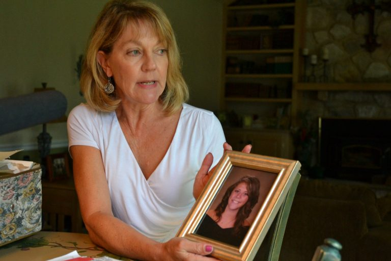 Martha Stringer holds a photo of her daughter, Kim, from when she was in high school. Kim lives with a serious mental illness. Her parents have struggled to get Kim help, because Kim often refuses treatment. (Brett Sholtis / Transforming Health)