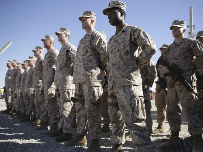 U.S. Marines stand guard during the change of command ceremony at Shorab military camp in Afghanistan's Helmand province in January 2018. (Massoud Hossaini/AP Photo)