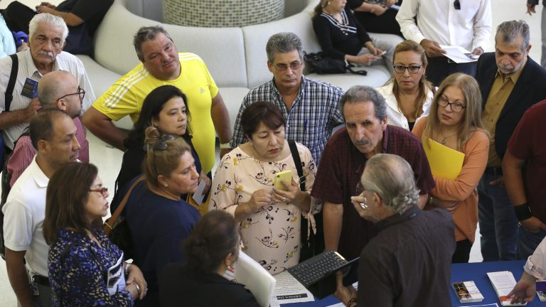 People inquire about temporary positions available for the 2020 census during a job fair in Miami in September 2019. (Lynne Sladky/AP Photo)