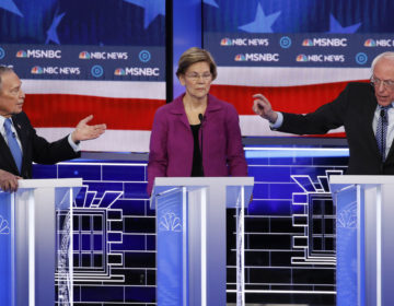 Former New York City Mayor Michael Bloomberg (left), Sen. Elizabeth Warren and Sen. Bernie Sanders participate in last week's Democratic presidential primary debate in Las Vegas. (John Locher/AP Photo)