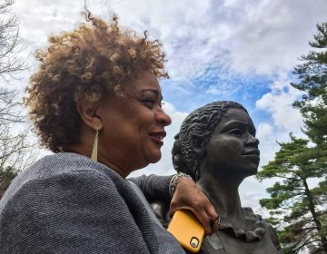 JerriAnne Boggis, executive director of the Black Heritage Trail of New Hampshire, poses with a monument that was erected in Harriet E. Wilson's honor. Boggis says when she read Wilson's book, she felt as if it was written the book just for her. (Verónica G. Cárdenas for NPR)