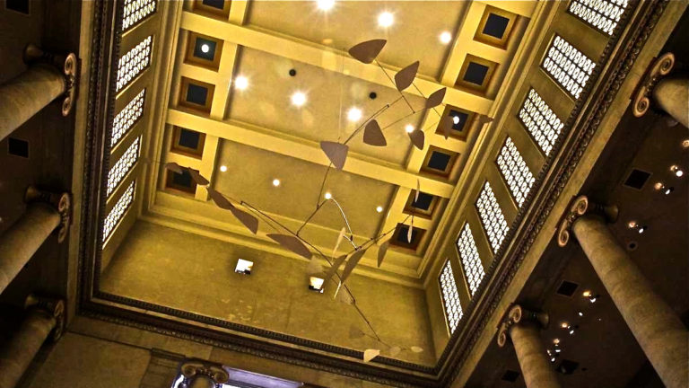 The mobile 'Ghost' by Alexander Calder hangs in the Great Stair Hall of the Philadelphia Museum of Art. (Kimberly Paynter/WHYY)