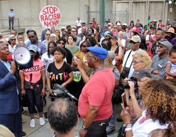 Protesters gather at Philadelphia police headquarters to call for action against police officers who posted racist comments on Facebook. (Emma Lee/WHYY)