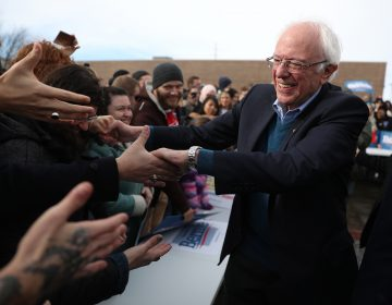 Vermont Sen. Bernie Sanders greets people at a campaign field office in Cedar Rapids, Iowa. Sanders is the slight favorite to win the caucuses, and he hopes it vaults him to the Democratic nomination. (Joe Raedle/Getty Images)