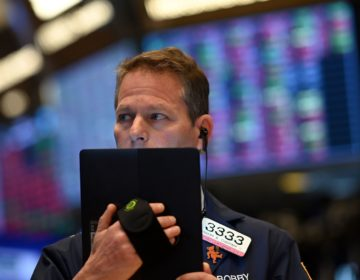 Traders work during the opening bell at the New York Stock Exchange on Thursday. Wall Street stocks opened sharply lower amid fears the coronavirus will grow into a significant international health crisis. (Johannes Eisele/AFP via Getty Images)