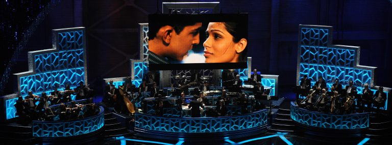 Musicians perform a song from Slumdog Millionaire during the 81st Annual Academy Awards on Feb. 22, 2009, in Hollywood, Calif. The film won 8 Oscars including Best Picture that year — and had box office returns to show for it. (Gabriel Bouys/AFP via Getty Images)