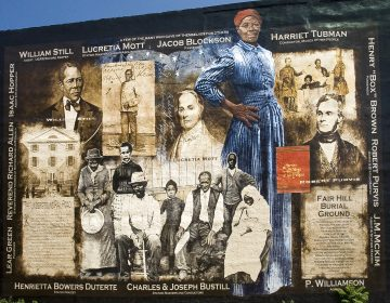 A mural on Germantown Avenue celebrates Harriett Tubman and other heroes of the Underground Railroad. (Mural Arts/ Painting by Sam Donovan, Photo by Jack Ramsdale)
