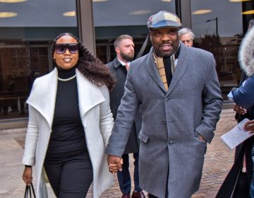 Councilman Kenyatta Johnson and his wife Dawn Chavous exiting federal court Friday. Kimberly Paynter/WHYY)