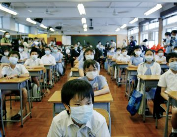 School was suspended for six weeks in Hong Kong as part of the strategy to keep SARS from spreading. On May 12, 2003, primary school children returned to class amid signs that the outbreak was coming under control. (Bobby Yip/Reuters)
