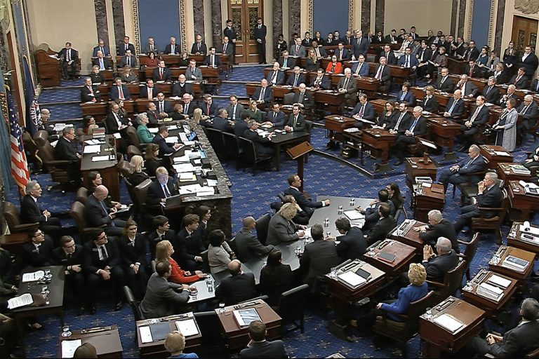 Senators vote on the first article of impeachment during the trial against President Donald Trump on Wednesday, Feb. 5, 2020 (Senate Television via AP)