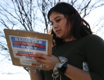 Karina Shumate, 21, a college student, filled out a voter registration form in Richardson, Texas on Jan. 18. One big registration effort this year has drawn controversy among elections officials. (LM Otero/AP Photo)