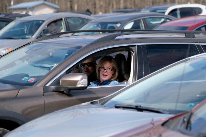 A parishioner sings while in her car during Bethany Wesleyan Church's Sunday worship service at Becky's Drive-In. (Matt Smith for Keystone Crossroads)