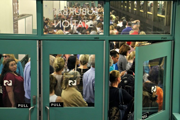 Regional rail passengers pack the platforms at Suburban Station at rush hour on July 5, 2016. (Emma Lee/WHYY)