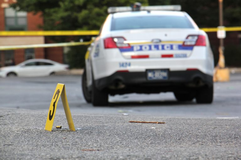Police investigate a drive-by shooting in Germantown on Oct. 3, 2018. (Emma Lee/WHYY)