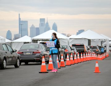 Cars line up at a drive-thru coronavirus test station in the parking lot at Citizens Bank Park.