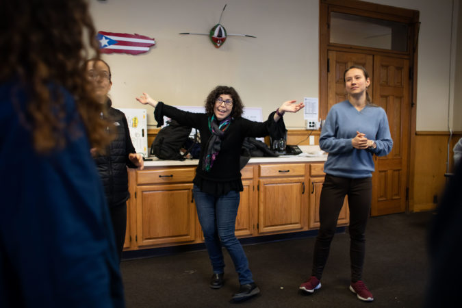 Lisa Jo Epstein (center), Artistic and Executive Director of Just Act, leads rehearsal for the play