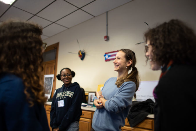 Jayla Williams (left) and Karolina Cernakova (center) participate in a warm-up exercise during rehearsal for the play
