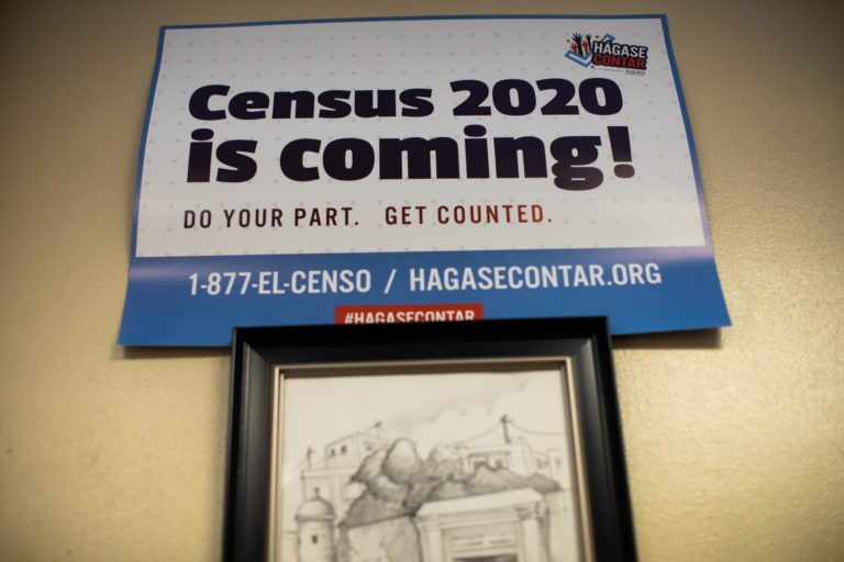 Signs posted around the offices of Ceiba in Norris Square, Kensington encourage visitors to participate in the 2020 census. (Becca Haydu for WHYY)