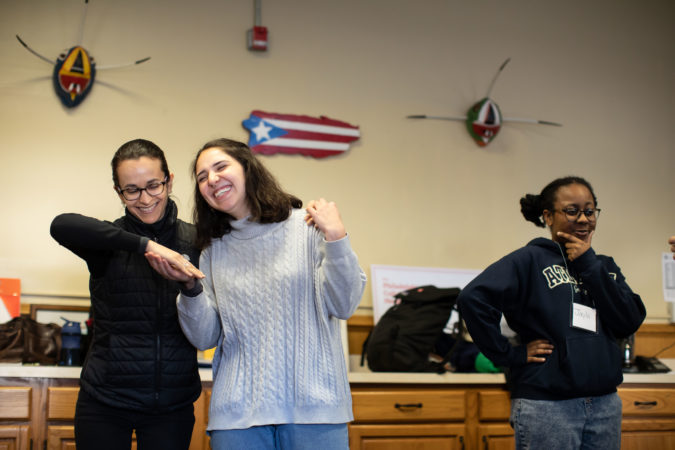 Andria Bibiloni and Laura Beery (left) participate in a warm-up exercise during rehearsal for the play
